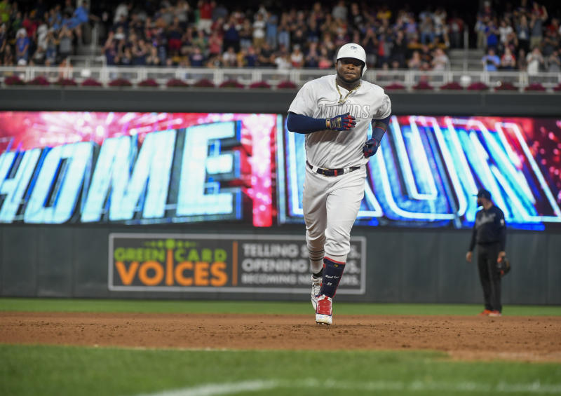 Minnesota Twins Miguel Sano rounds the bases after hitting a three-run home run against the Detroit Tigers during the fifth inning of a baseball game Saturday, Aug. 24, 2019, in Minneapolis. The Twins won 8-5. (AP Photo/Craig Lassig)