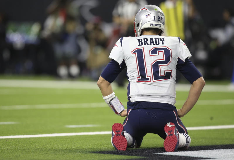 Dec 1, 2019; Houston, TX, USA; New England Patriots quarterback Tom Brady (12) reacts after being sacked by the Houston Texans in the second half at NRG Stadium. Mandatory Credit: Thomas B. Shea-USA TODAY Sports