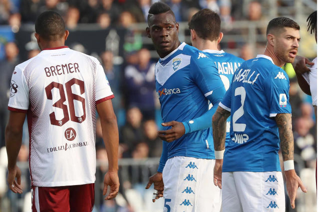 Brescia'a Mario Balotelli, center, walks on the pitch during the Serie A soccer match between Brescia and Torino at the Mario Rigamonti Stadium in Brescia, Italy, Saturday, Nov. 9, 2019. (Filippo Venezia/ANSA via AP)