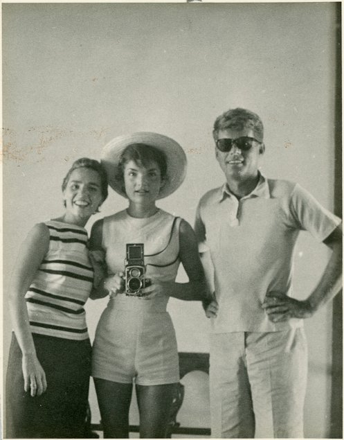 """Ethel Kennedy (wife of Robert F. Kennedy) smiles, Jackie Kennedy gazes, and JFK can't help but look stylish in Wayfarer-like shades. Photo taken in 1954. <a href=""""http://www.mcinnisauctions.com/"""" rel=""""nofollow noopener"""" target=""""_blank"""" data-ylk=""""slk:(Photo courtesy of John McInnis Auctioneers)"""" class=""""link rapid-noclick-resp"""">(Photo courtesy of John McInnis Auctioneers)</a>"""
