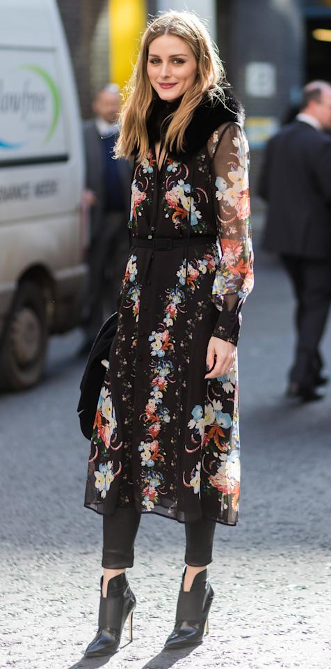 <p>The style star was spotted outside of the Erdem LFW show in a floral print dress over leather leggings. She topped off the chic cold-weather look with a black scarf and heeled booties.</p>