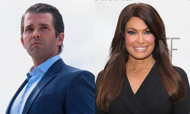 Amour! Don Trump Jr. and Kimberly Guilfoyle cozy up in Paris. (Photo: Getty Images)