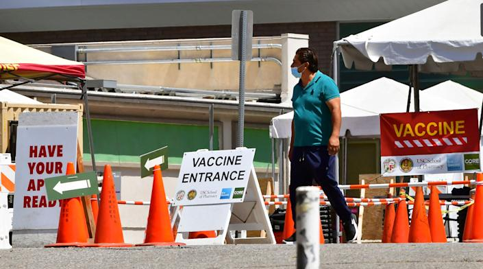 A man arrives at a near-empty Covid-19 vaccine facility in Los Angeles, California on May 3, 2021. (Frederic J. Brown/AFP via Getty Images)