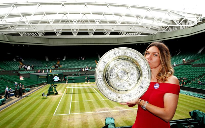Ladies' Singles ChLadies' Singles Champion, Simona Halep of Romania poses for a photo with the trophy in the Royal Box on centre courtampion, Simona Halep of Romania poses for a photo with the trophy in the Royal Box on centre court - Getty Images Europe