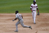 Detroit Tigers' Akil Baddoo, left, runs to third after stealing second base after Chicago White Sox second baseman Nick Madrigal could not make the play on a throwing error by catcher Yasmani Grandal as White Sox shortstop Tim Anderson looks on during the third inning of a baseball game in Chicago, Sunday, June 6, 2021. (AP Photo/Nam Y. Huh)
