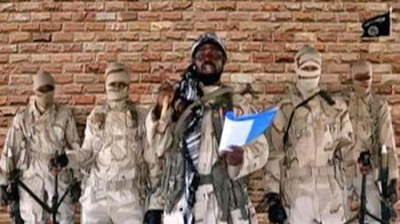 Leader of one of the Boko Haram group's factions, Abubakar Shekau speaks in front of guards in an unknown location in Nigeria