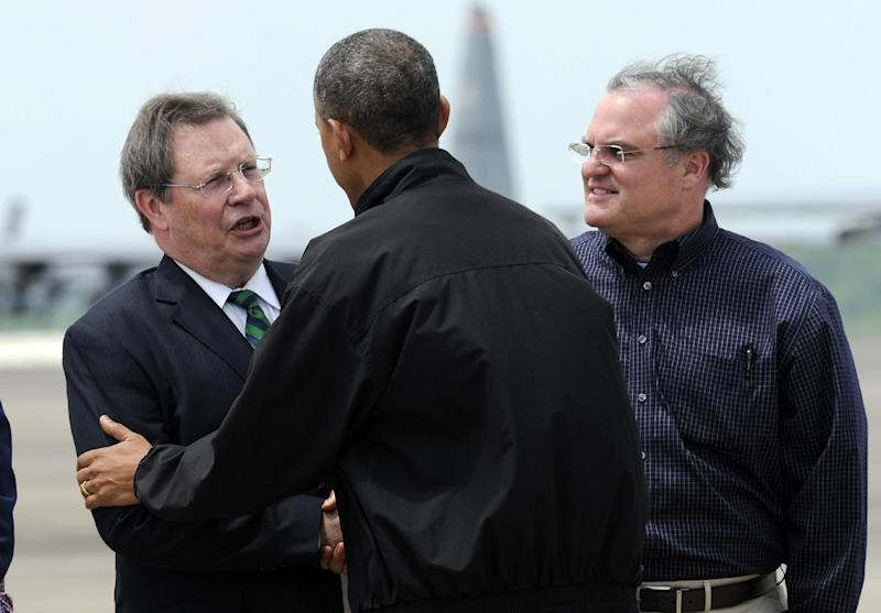 President Barack Obama, center, talks with Mark Stodola, Mayor of Little Rock, left, as Sen. Mark Pryor, D-Ark., right, watches after Obama walked off of Air Force One at Little Rock Air Force Base, Ark., Wednesday, May 7, 2014. Obama is visiting with first responders and families affected by the recent tornados. (AP Photo/Susan Walsh)