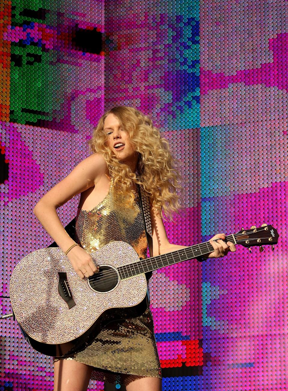 <p>The way the sun reflected off the sequins on this dress, along with Taylor's guitar, is really quite mesmerizing. She wore it to play at the Sound Relief concert in Sydney, Australia in March 2009.</p>