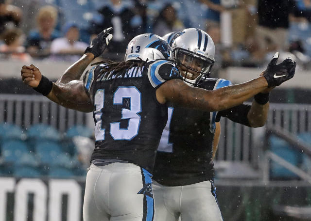Panthers QB Cam Newton, right, celebrates after throwing a touchdown pass to WR Kelvin Benjamin against the Jaguars on Thursday. (AP)