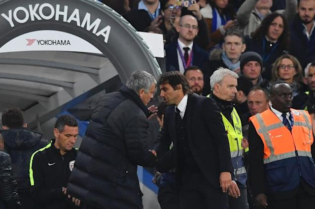 Manchester United's manager Jose Mourinho (L) talks to Chelsea head coach Antonio Conte after the final whistle at Stamford Bridge in London on October 23, 2016 (AFP Photo/Ben Stansall)