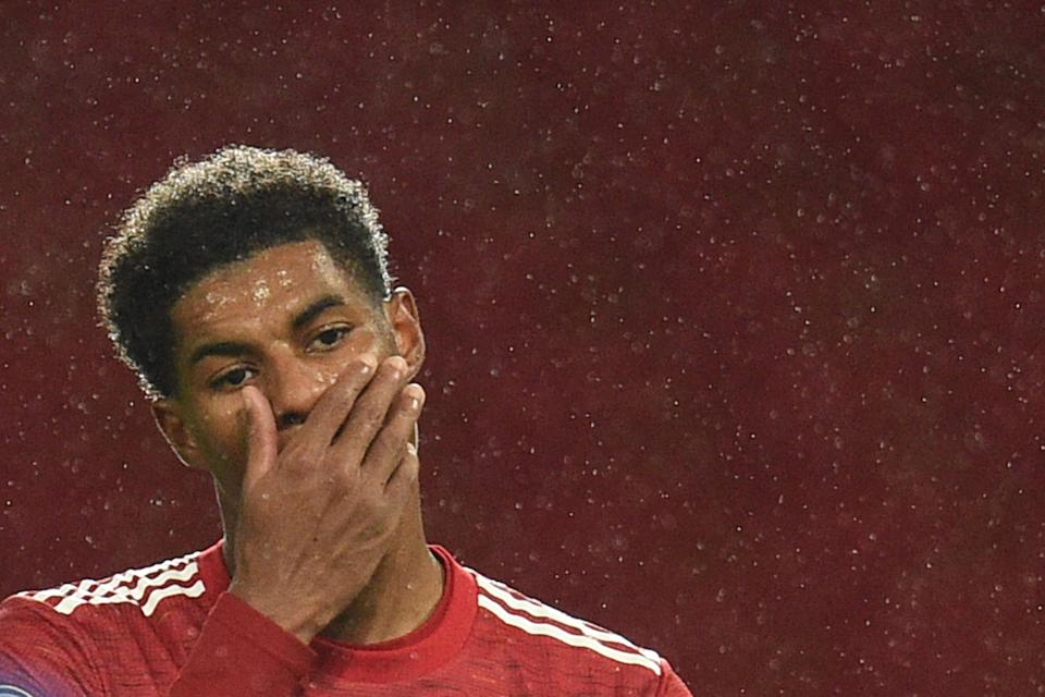 Manchester United's English striker Marcus Rashford (L) reacts during the English Premier League football match between Manchester United and Chelsea at Old Trafford in Manchester, north west England, on October 24, 2020. (Photo by Oli SCARFF / POOL / AFP) / RESTRICTED TO EDITORIAL USE. No use with unauthorized audio, video, data, fixture lists, club/league logos or 'live' services. Online in-match use limited to 120 images. An additional 40 images may be used in extra time. No video emulation. Social media in-match use limited to 120 images. An additional 40 images may be used in extra time. No use in betting publications, games or single club/league/player publications. /  (Photo by OLI SCARFF/POOL/AFP via Getty Images)