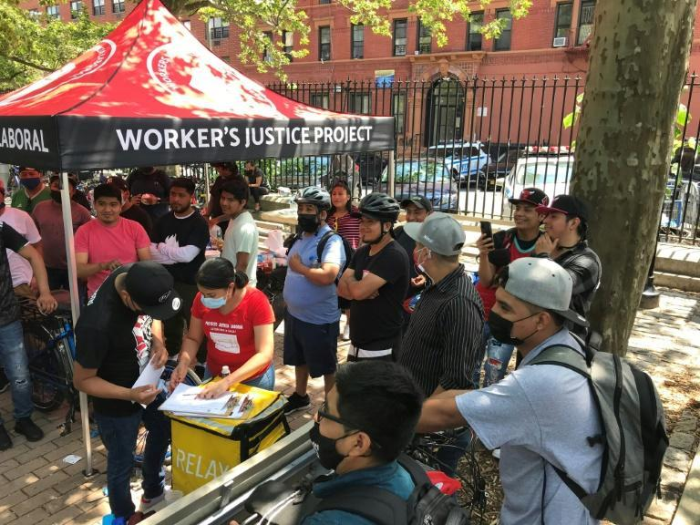 """Hispanic food delivery men registered as members of the """"Los Deliveristas Unidos"""" movement in Washington Heights, New York, on June 20, 2021"""