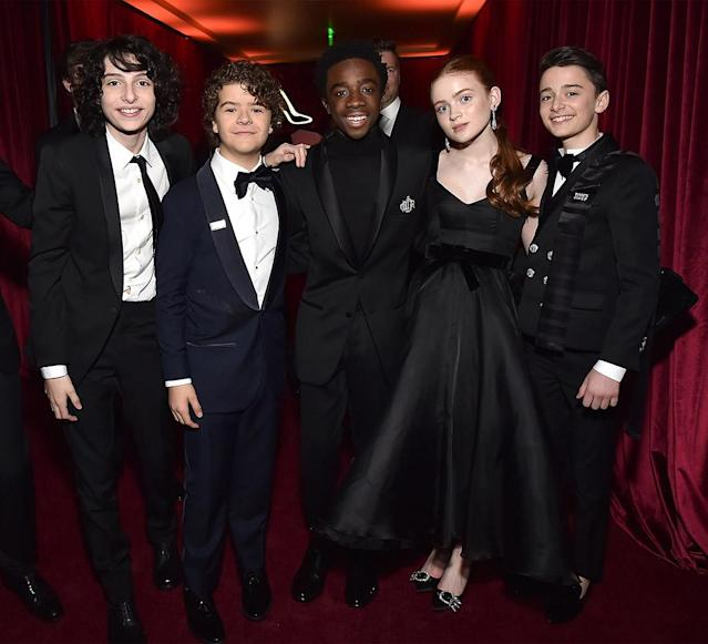 <p><em>Stranger Things</em> stars Finn Wolfhard, Gaten Matarazzo, Caleb McLaughlin, Sadie Sink, and Noah Schnapp attended the Netflix Golden Globes party together. (Photo: Kevin Mazur/Getty Images for Netflix) </p>