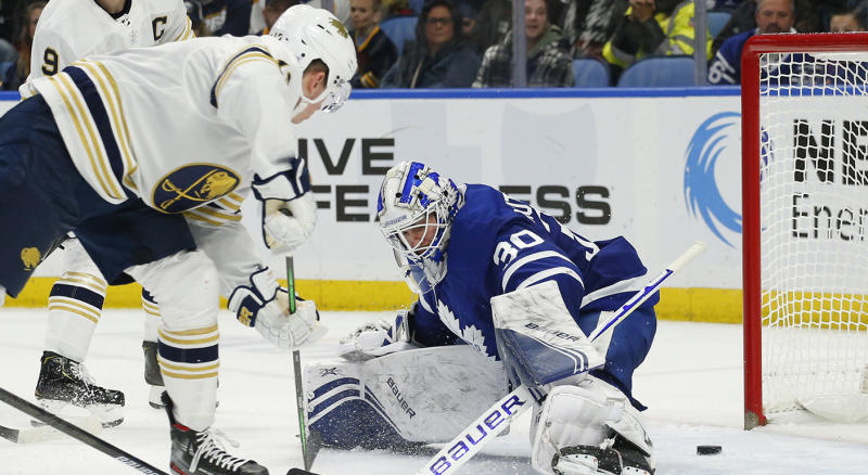 Buffalo Sabres forward Jimmy Vesey (13) puts the puck past Toronto Maple Leafs goalie Michael Hutchinson (30) during the third period of an NHL hockey game Friday, Nov. 29, 2019, in Buffalo, N.Y. (AP Photo/Jeffrey T. Barnes)