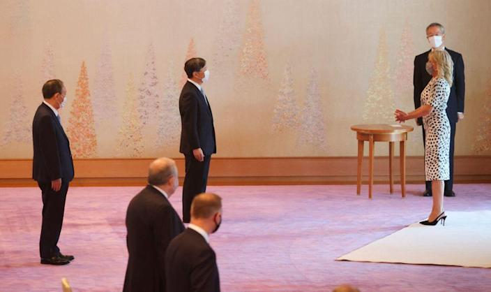 Japanese Emperor Naruhito (C) meets with the U. S. First Lady Jill Biden (R) at Imperial Palace in Tokyo on July 23, 2021, as Japanese Prime Minister Yoshihide Suga watches. - Credit: AP