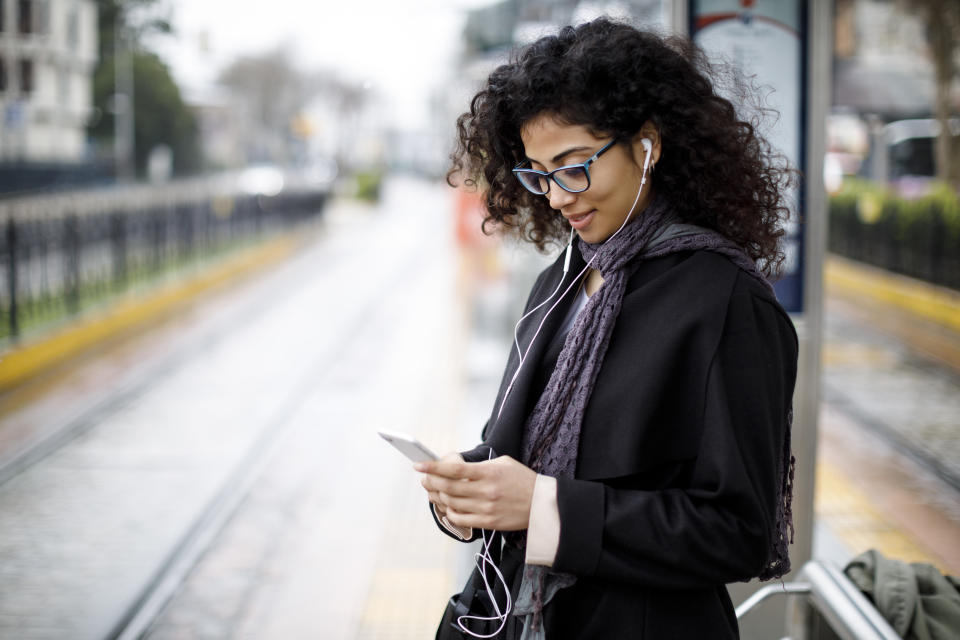 Woman waiting at tram stop. Source: Getty Images