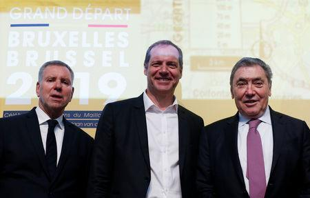 Belgian politician Alain Courtois, Tour de France director Christian Prudhomme and former Belgian cycling champion Eddy Merckx pose during the presentation of the Grand Depart of the 2019 Tour de France cycling race in Brussels, Belgium, January 16, 2018. REUTERS/Francois Lenoir