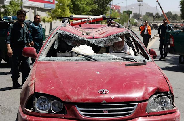 <p>An Afghan man drives his damaged car after a suicide attack in Kabul, Afghanistan, Wednesday, May 31, 2017. (AP Photos/Rahmat Gul) </p>