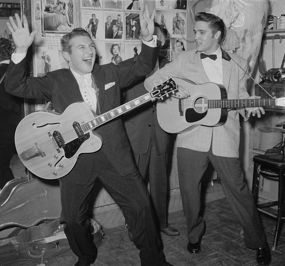 <p>Liberace and Elvis Presley jam backstage at a night club in 1956. They first met when Liberace went to the Frontier to see Presley perform. Presley returned the favor and went to the Riviera to see Liberace's act. </p>