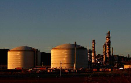 FILE PHOTO - The Woodside Petroleum gas plant is seen at sunset in Burrup, in the Pilbarra region of Western Australia