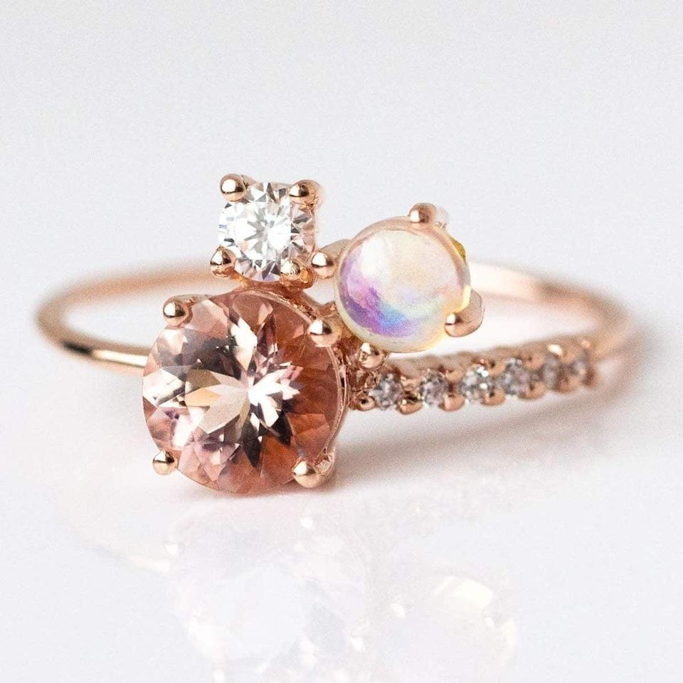 """<p>The <a href=""""https://www.popsugar.com/buy/Blushing-Venus-Cluster-Ring-531210?p_name=Blushing%20Venus%20Cluster%20Ring&retailer=localeclectic.com&pid=531210&price=125&evar1=fab%3Aus&evar9=44555978&evar98=https%3A%2F%2Fwww.popsugar.com%2Fphoto-gallery%2F44555978%2Fimage%2F47011759%2FBlushing-Venus-Cluster-Ring&list1=wedding%2Cjewelry%2Crose%20gold%2Cengagement%20rings&prop13=api&pdata=1"""" rel=""""nofollow noopener"""" class=""""link rapid-noclick-resp"""" target=""""_blank"""" data-ylk=""""slk:Blushing Venus Cluster Ring"""">Blushing Venus Cluster Ring</a> ($125) features an uneven setting that's both unique and pretty.</p>"""