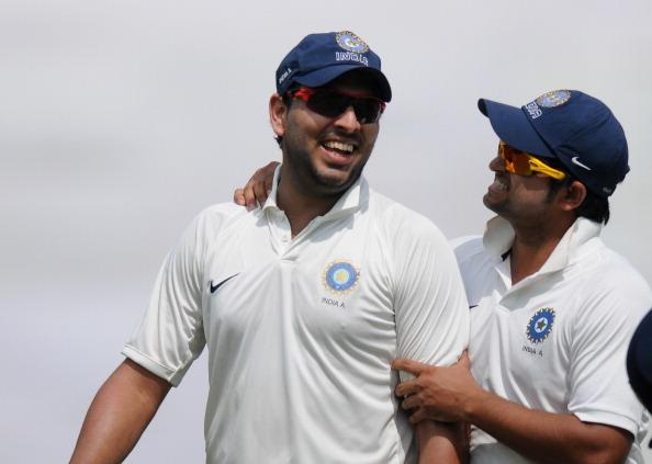 MUMBAI, INDIA - NOVEMBER 01:  Yuvraj Singh (R) of India 'A'  is congratulatede by teammate and captain Suresh Raina as they walk back to the pavilion after the end of  second innings during the final day of the first practice match between England and India 'A' at the CCI (Cricket Club of India) ground, on November 1, 2012 in Mumbai, India.  (Photo by Pal Pillai/Getty Images)