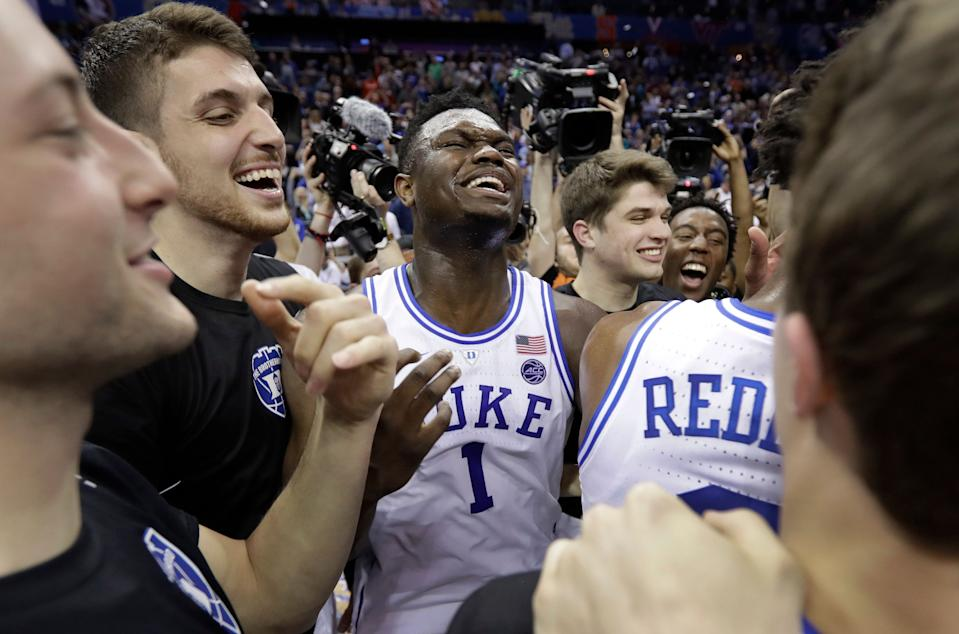 Duke's Zion Williamson (1) celebrates with teammates after Duke defeated Florida State in the NCAA college basketball championship game of the Atlantic Coast Conference tournament in Charlotte, N.C., Saturday, March 16, 2019. (AP Photo/Chuck Burton)