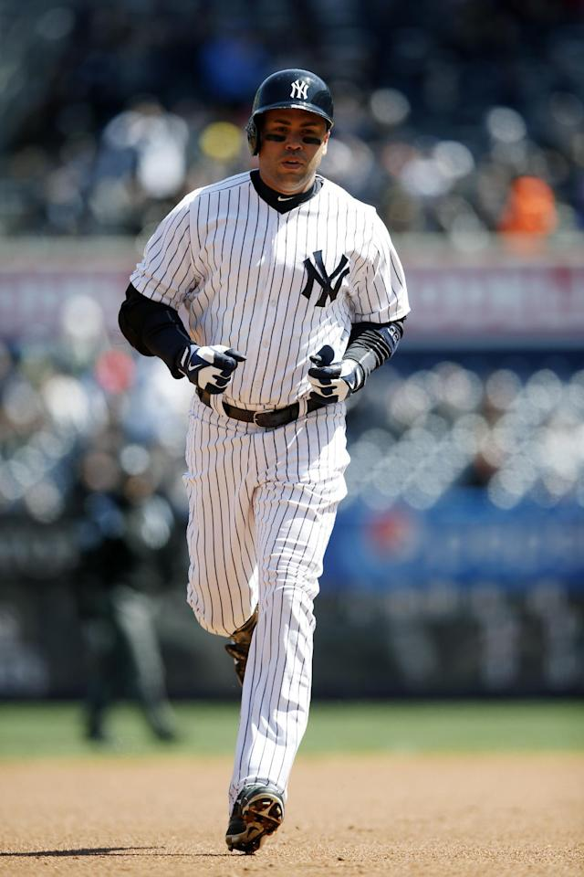 New York Yankees' Carlos Beltran trots the bases after hitting a first-inning, solo home run off Chicago Cubs starting pitcher Jason Hammel in Game 1 of an interleague baseball doubleheader at Yankee Stadium in New York, Wednesday, April 16, 2014. (AP Photo/Kathy Willens)