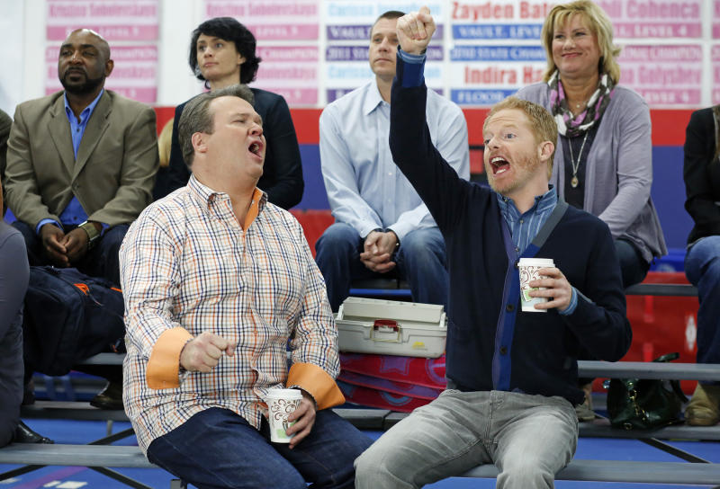 """This TV publicity image released by ABC shows Eric Stonestreet, as Cameron, left, and Jesse Tyler Ferguson as Mitchell in a scene from the comedy """"Modern Family."""" The ACLU is lobbying for the gay couple on """"Modern Family"""" to get married. ACLU Action started a campaign to urge the show's producers to script a wedding episode for Mitchell and Cameron, already fathers of an adopted child and one of three couples at the heart of the show. (AP Photo/ABC, Jordin Althaus)"""