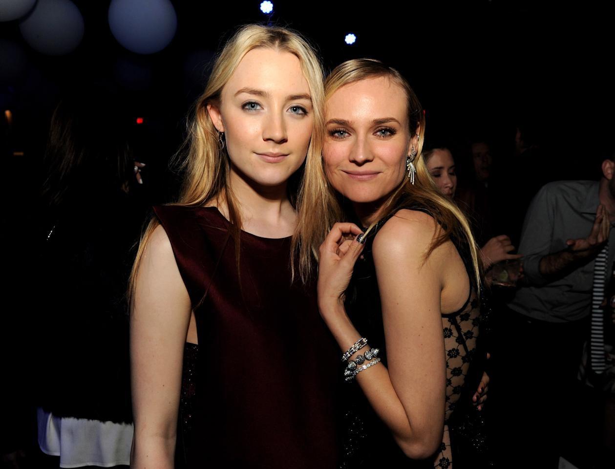 """LOS ANGELES, CA - MARCH 19:  Actresses Saoirse Ronan (L) and Diane Kruger pose at the after party for the premiere of Open Road Films' """"The Host"""" at Lure on March 19, 2013 in Los Angeles, California.  (Photo by Kevin Winter/Getty Images)"""