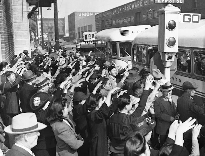 Japanese-American residents of Los Angeles wave a farewell to relatives and friends who are being deported to Japan in October 1941. | Hulton-Deutsch Collection/Corbis/Getty Images
