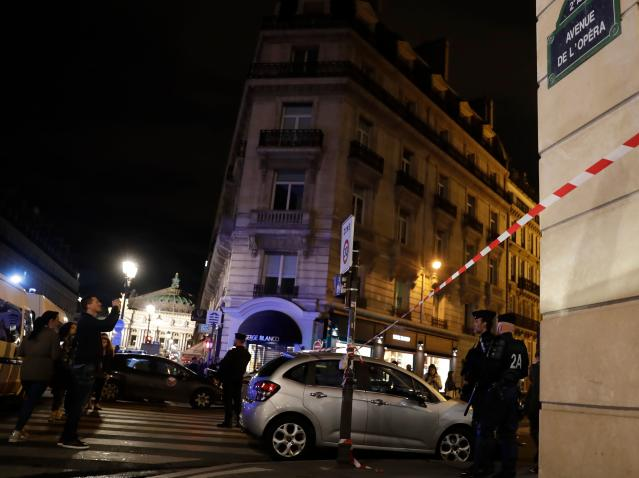<p>Policemen stand guard in Paris centre after one person was killed and several injured by a man armed with a knife, who was shot dead by police in Paris on May 12, 2018. (Photo: Thomas Samson/AFP/Getty Images) </p>