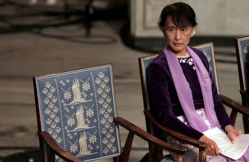 FILE PHOTO: Myanmar opposition leader Aung San Suu Kyi sits before giving her Nobel Lecture at City Hall in Oslo