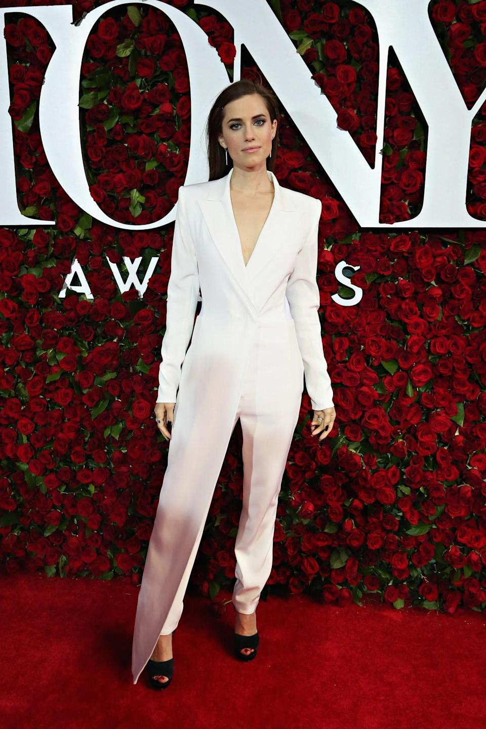 <p>The 'Girls' actress opted for an asymmetric DKNY suit at an event this summer. [Photo: Getty] </p>