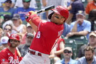 Cincinnati Reds' Joey Votto, right, andTyler Naquin watch Votto's two-run home run off Chicago Cubs starting pitcher Alec Mills during the first inning of a baseball game Thursday, July 29, 2021, in Chicago. Jesse Winker also scored on the play. (AP Photo/Charles Rex Arbogast)