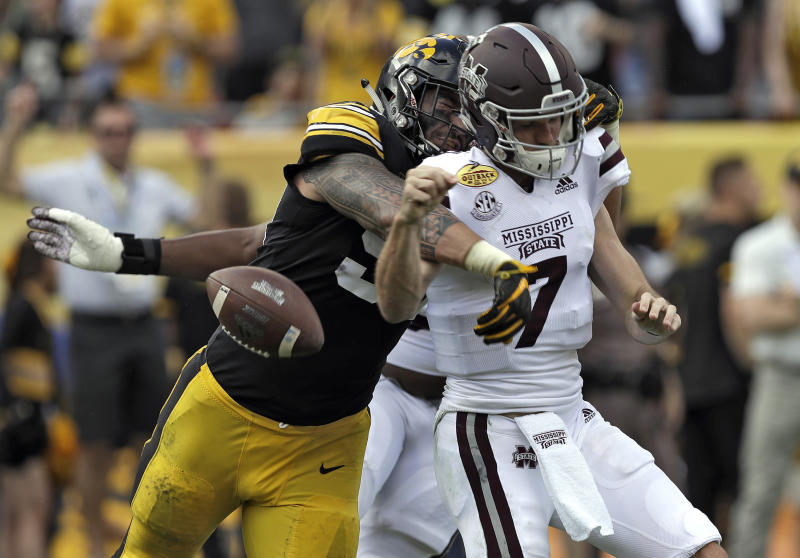 FILE - In this Jan. 1, 2019, file photo, Iowa defensive end A.J. Epenesa (94) strips the ball from Mississippi State quarterback Nick Fitzgerald (7) causing a fumble during the first half of the Outback Bowl NCAA college football game, in Tampa, Fla. Iowa junior A.J. Epenesa knows that he has a strong shot at being picked in the first round of the 2020 NFL Draft should he choose to go pro next spring. Hes just choosing not to think about it until then. Epenesa, a 6-foot-6, 280-pound defensive end who led the Big Ten with 10.5 sacks a year ago despite coming off the bench, is poised for a monster season in 2019. (AP Photo/Chris O'Meara, File)
