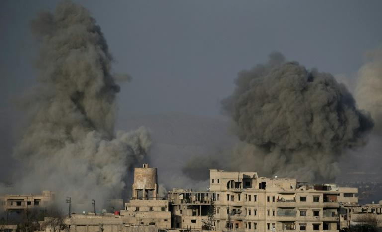 Smoke billows following Syrian government bombardments in the Eastern Ghouta region on March 3, 2018