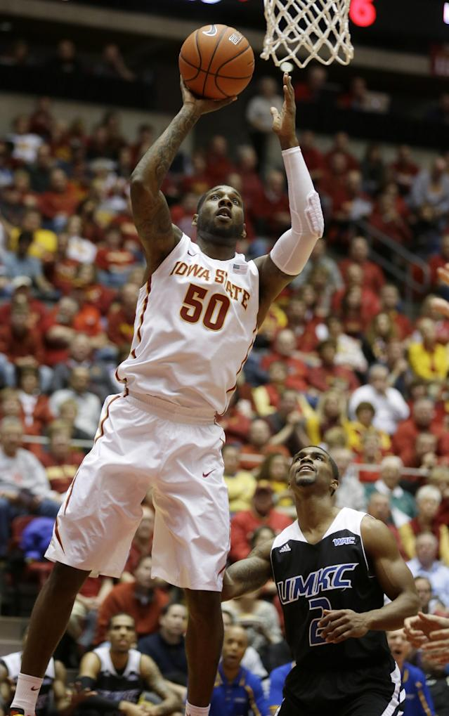 Iowa State guard DeAndre Kane (50) shoots over Missouri-Kansas City guard Aaron Washington, right, during the first half of an NCAA college basketball game, Monday, Nov. 25, 2013, in Ames, Iowa. Kane scored 20 points as Iowa State won 110-51. (AP Photo/Charlie Neibergall)