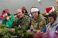 This Dec. 24, 2019 photo provided by The North American Aerospace Defense Command (NORAD) shows members of NORAD tracking Santa team at the NORAD Tracks Santa Operations Center on Peterson Air Force Base, Colo. This is the 65th year for the U.S.-Canadian operation that has tracked the jolly old man since a child mistakenly called the base asking to speak to Santa. (Tech. Sgt. Jeff Fitzmorris/NORAD via AP)