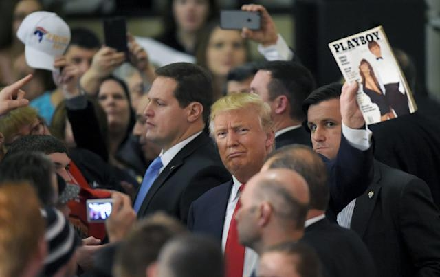 <p>Republican presidential candidate Donald Trump holds up the March 1990 issue of <em>Playboy</em> with him on the cover as he works the rope line after a campaign rally in Farmington, N.H., Jan. 25, 2016. (Photo: Gretchen Ertl/Reuters) </p>