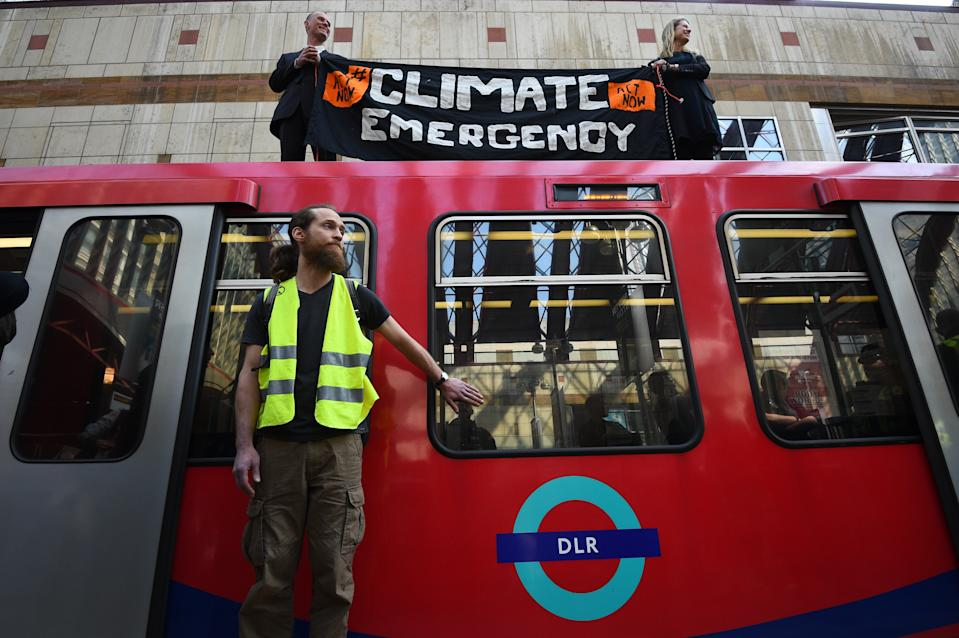 File photo dated 17/04/19 of climate activists Cathy Eastburn, 51 from Lambeth, south London and Luke Watson, 29, of Manuden, Essex,(both top) and Mark Ovland, 35 of Somerton, Somerset, glued to a Docklands Light Railway train at Canary Wharf station.