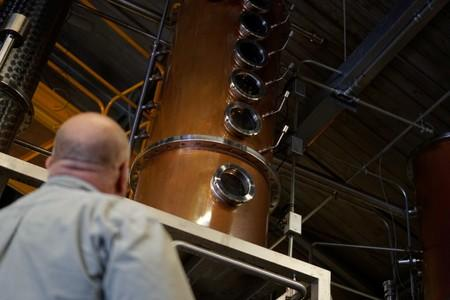 Herman Mihalich looks at the distillation column where his rye whisky is made in his distillery in Bristol Pennsylvania