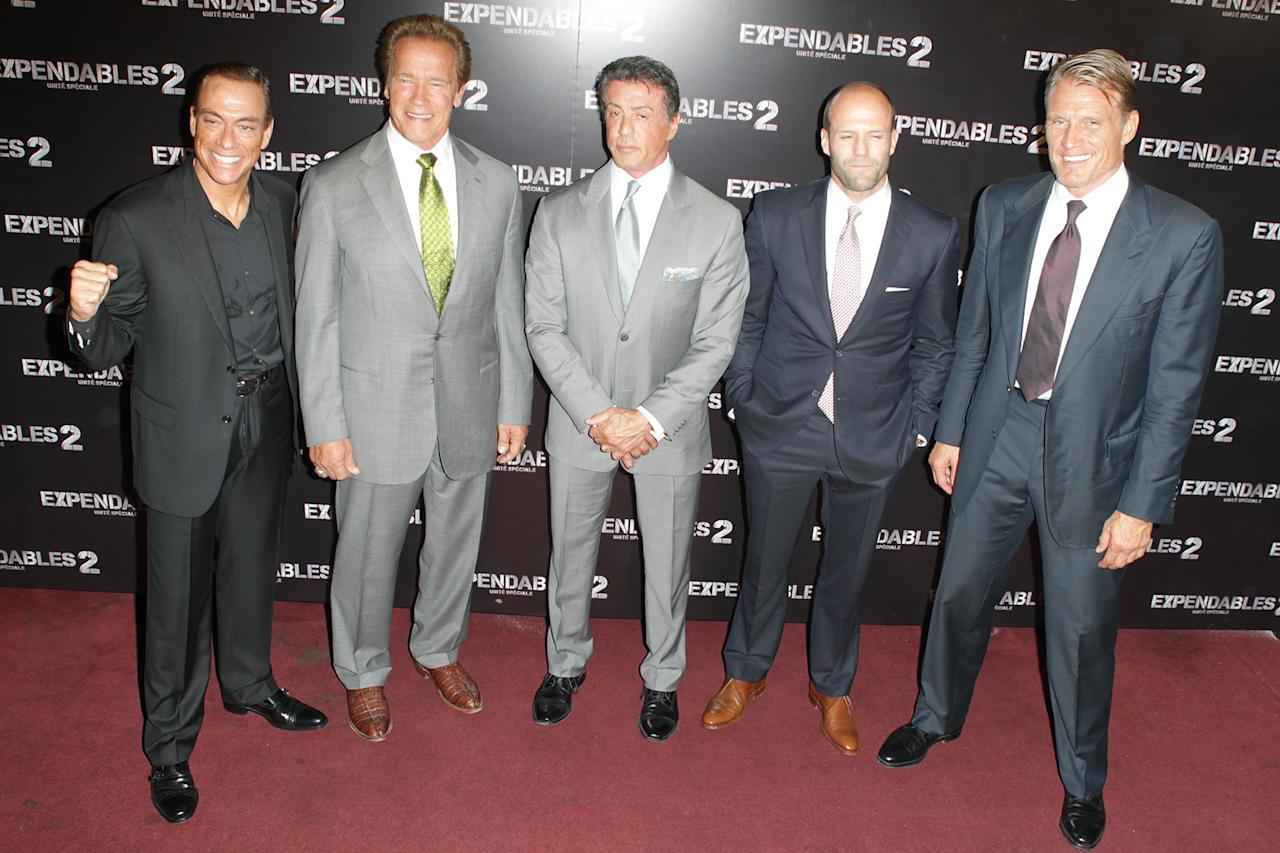 "Jean Claude Van Damme, Arnold Schwarzenegger, Sylvester Stallone, Jason Statham and Dolph Lundgren at the Paris premiere of ""The Expendables 2"" on August 9, 2012."