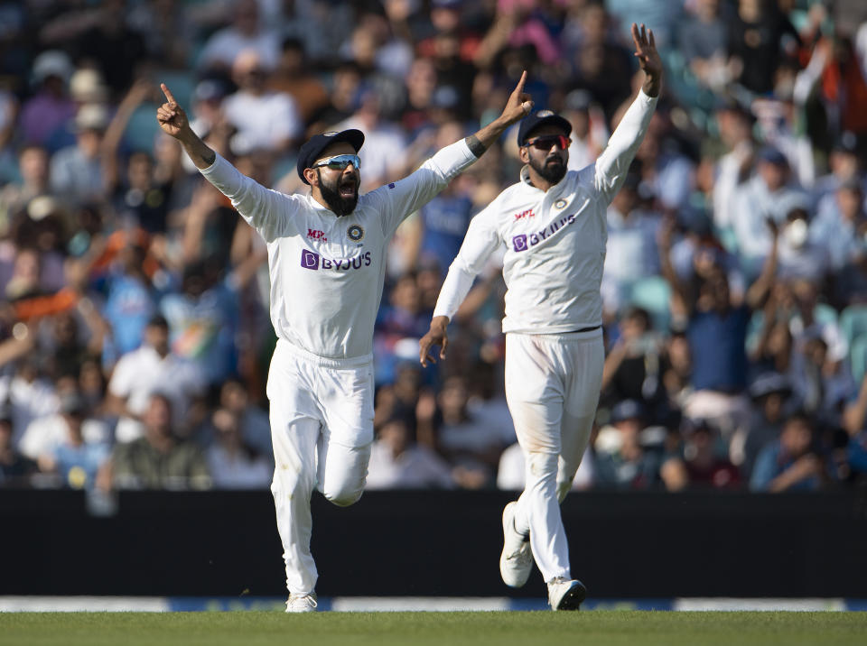 Seen here, India captain Virat Kohli (left) celebrates the moment of victory during the fourth Test against England.