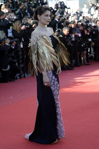 "Laetitia Casta The French actress wore Christian Dior couture for the ""Zulu"" premiere. Over the Spring 2013 dress she wore an eye-catching gold feathered bolero."