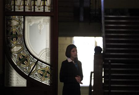 A woman stands in the lobby of the Liszt Academy music school in Budapest October 21, 2013. REUTERS/Laszlo Balogh