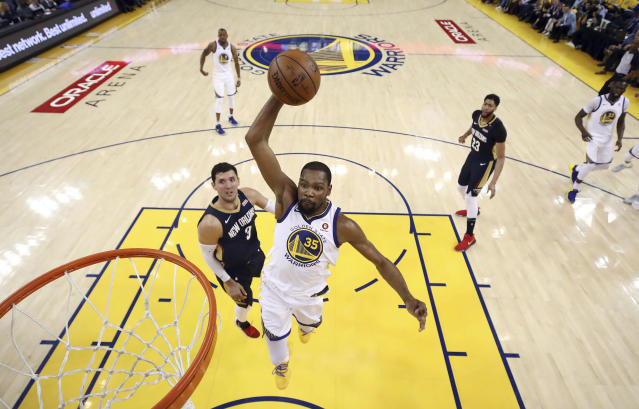 Golden State Warriors' Kevin Durant (35) dunks past New Orleans Pelicans' Nikola Mirotic, left, during the first half in Game 5 of an NBA basketball second-round playoff series Tuesday, May 8, 2018, in Oakland, Calif. (Ezra Shaw/Pool Photo via AP)