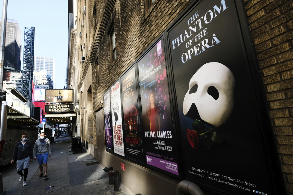 FILE - Broadway posters appear outside the Richard Rodgers Theatre during Covid-19 lockdown in New York on May 13, 2020. As Broadway reopens this fall, proof of full vaccination are required for entry and masks are mandated while moving through the theater. (Photo by Evan Agostini/Invision/AP, File)