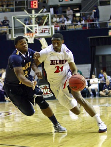 Belmont guard Ian Clark (21) drives against Murray State guard Dexter Fields (23) during the first half of an NCAA college basketball game in the Ohio Valley Conference tournament championship on Saturday, March 9, 2013, in Nashville, Tenn. (AP Photo/Wade Payne)