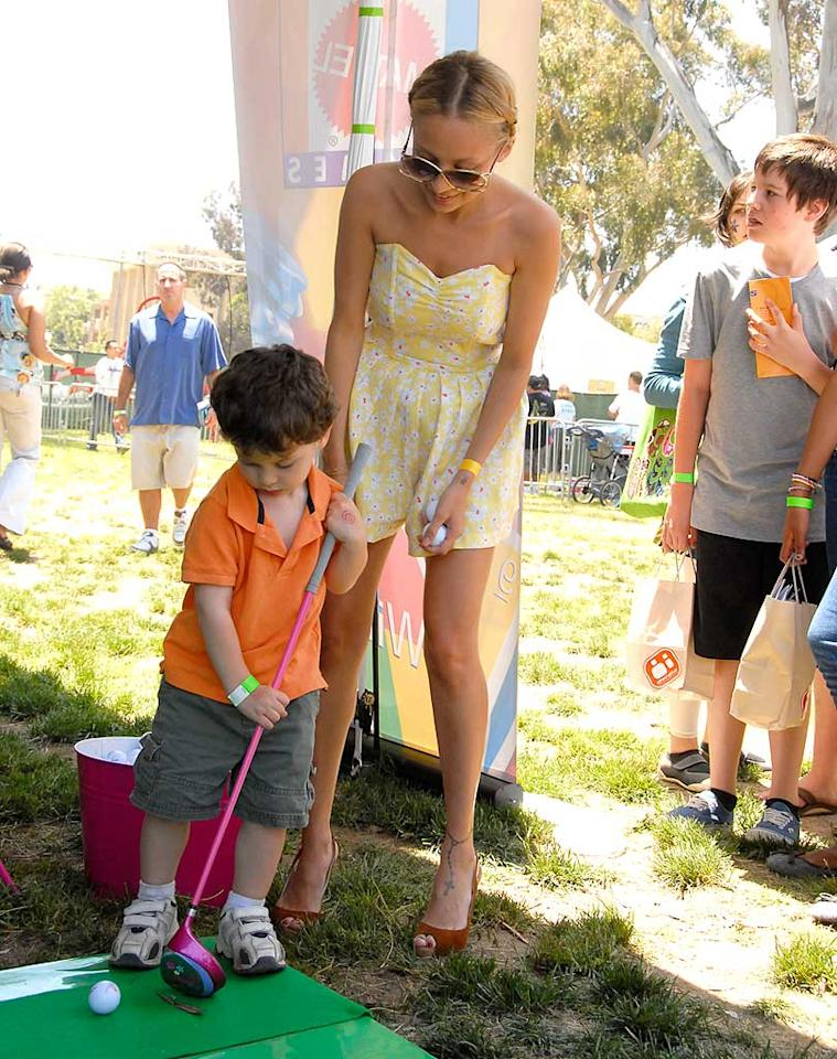 "New mom Nicole Richie plays caddy to a young golfer. But don't expect her to go retrieving balls in those heels! Barry King/<a href=""http://www.wireimage.com"" target=""new"">WireImage.com</a> - June 8, 2008"
